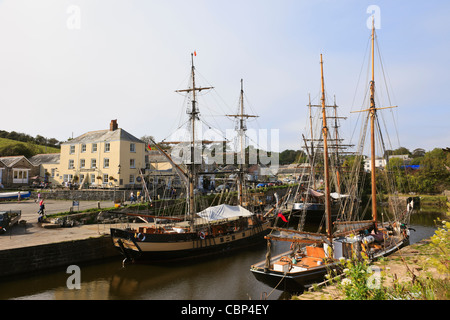 Charlestown, Cornwall, England, UK, Britain. Tall ships in the inner harbour with the Pier House Hotel on the quayside - Stock Photo