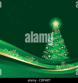 Glowing green and gold Christmas tree in a green winter garden - Stock Photo