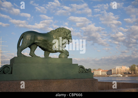 One of the lion sculptures at the Dvortsovaya pier in bronze at the Admiralty embankment. Saint Petersburg, Russia. - Stock Photo