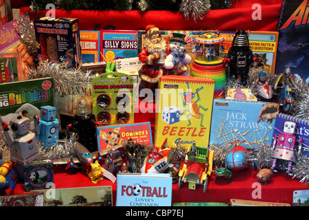 Christmas shop window in Bath selling vintage toys. - Stock Photo