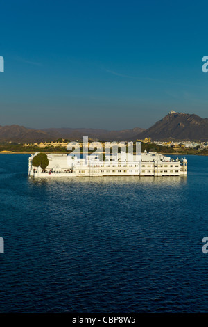 The Lake Palace Hotel, Jag Niwas, on island site on Lake Pichola in first light of early morning, Udaipur, Rajasthan, - Stock Photo