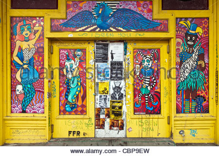 Graffiti on the side of Café Brasil on Frenchman Street, New Orleans, Louisiana, United States - Stock Photo