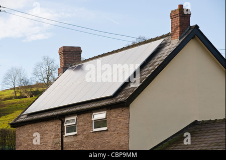 Solar panels for electricity generation on roof of rural detached house at St Margarets Herefordshire England UK - Stock Photo