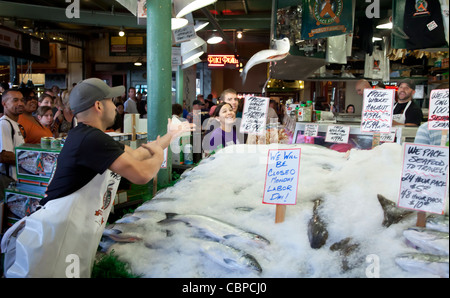 Flying fish, Pike Place Fish Market, Seattle, Washington, USA - Stock Photo