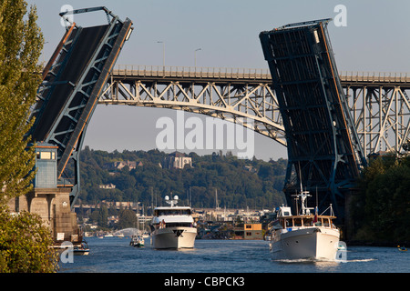 Yachts passing through Fremont Bridge draw bridge, Seattle, Washington, USA - Stock Photo