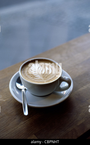 Rosetta latte art in the microfoam topping of a Cappuccino. - Stock Photo