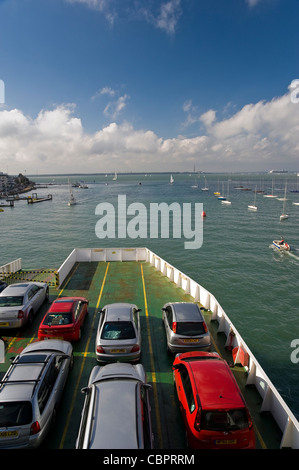 The car deck of an Isle of Wight ferry leaving East Cowes for Southampton, Hampshire, UK - Stock Photo