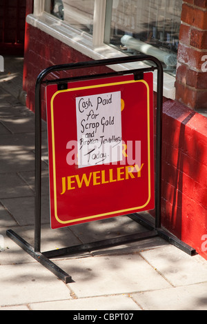 Cash for scrap gold and broken Jewellery sign - Stock Photo