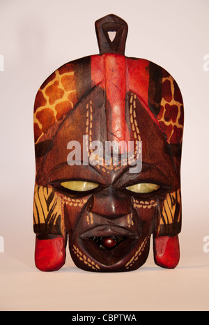 Wooden South African mask isolated on light bacground - Stock Photo