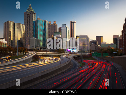 The I-85 highway and midtown Atlanta in the late afternoon - Stock Photo