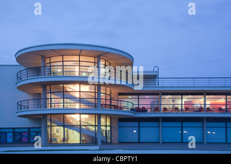 Close-up of De la Warr Pavilion, Bexhill, Sussex, illuminated at dusk. - Stock Photo