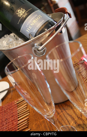 Champagne on ice with two glasses - Stock Photo