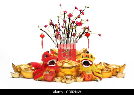 Chinese New Year Decorations--Traditional Dancing Lions,Gold Ingots,Red Packet and Plum Tree. - Stock Photo