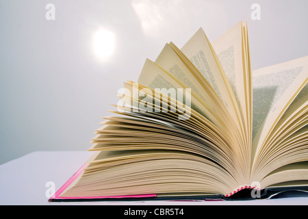 Opened book on white background, Isolated object - Stock Photo