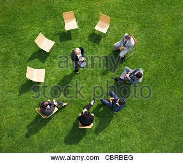 Business people having a meeting outdoors - Stock Photo