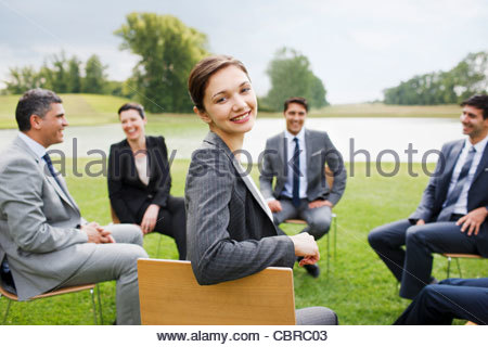 Business people having meeting outdoors - Stock Photo