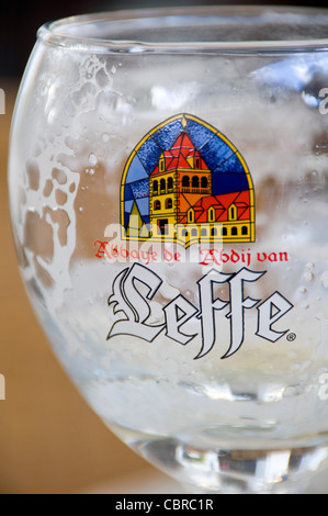 Vertical close up of an empty Leffe beer glass. - Stock Photo
