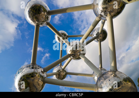 Horizontal close up of the nine reflective spheres of the Atomium monument in Heysel Park against a blue sky. - Stock Photo