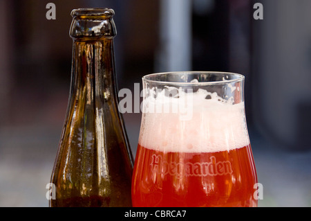 Horizontal close up of a traditional Hoegaarden Belgian beer in a distinctive tulip shaped glass. - Stock Photo
