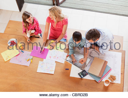Family relaxing together at table - Stock Photo