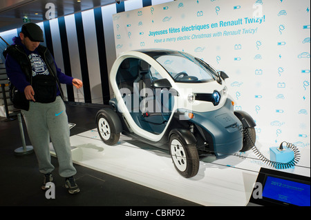 Paris, France, People inside New Car Showroom, Looking at Renault Mini Electric Car the 'Twizy' on Display Cars, - Stock Photo
