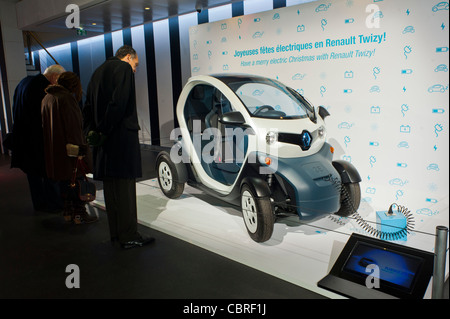 Paris, France, People inside New Car Showroom, Looking at Renault Mini Electric Car the 'Twizy' on Display - Stock Photo