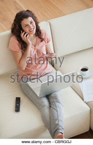 Woman shopping online with credit card - Stock Photo
