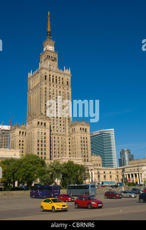 Cars parked in front of Palac Kultury i Nauki the Palace of Culture and Science at Plac Defilad square central Warsaw - Stock Photo