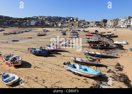 St Ives, Cornwall, England, UK, Great Britain. View of moored boats in the sandy harbour at low tide - Stock Photo