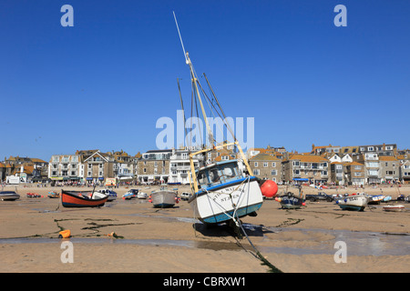 St Ives, Cornwall, England, UK, Great Britain. View of moored boats beached in the sandy harbour at low tide - Stock Photo