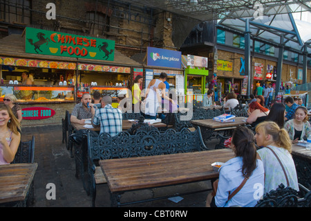 Eating area at Stables Market in Camden Town north London England UK Europe - Stock Photo