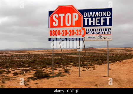 Warning sign of the Trans Hex Group Ltd. diamond mining company against the theft of diamonds, South Africa - Stock Photo