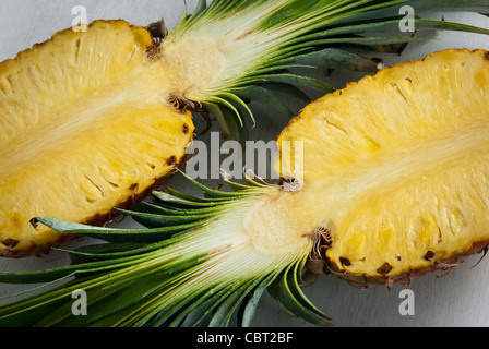 Pineapple cut in half on white background - Stock Photo
