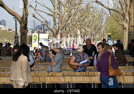 Secondhand book stalls, under Waterloo Bridge, on banks of the Thames, Southbank, London, England, UK - Stock Photo