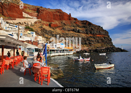 Partial view of Ammoudi, one of the 2 small harbors of famous Oia village, Santorini, Cyclades, Greece - Stock Photo