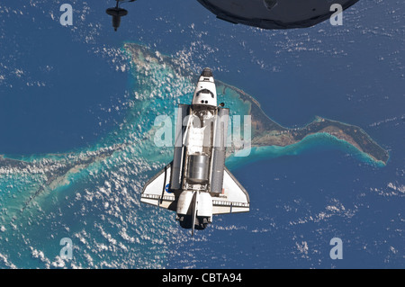 Space Shuttle Atlantis over Bahamas July 10, 2011 - Stock Photo