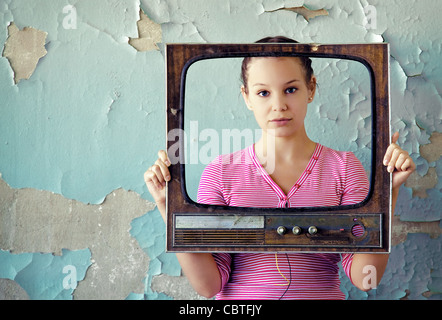 woman with old tv frame - Stock Photo