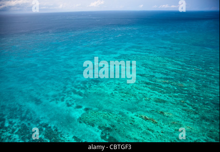 Aerial views of the spectacular Great Barrier Reef near the Whitsunday Islands in Queensland, Australia. - Stock Photo