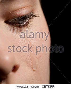 close-up of a young woman crying - Stock Photo