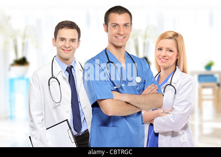 Medical team consisting of three smiling doctors - Stock Photo