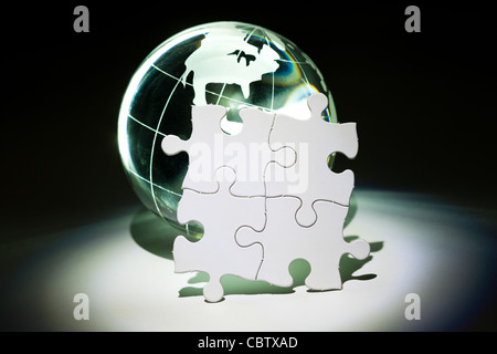 Globe and White Puzzle, business concept - Stock Photo