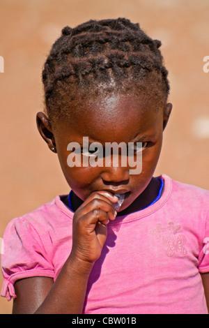 Young Herero girl, Damaraland, Namibia - Stock Photo