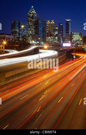 The I-85 highway and midtown Atlanta at night - Stock Photo