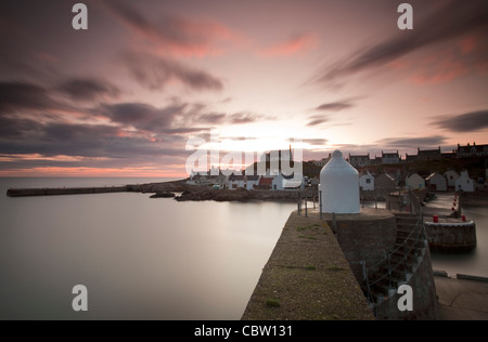 Sunrise and long exposure at Findochty fishing village on the Moray Firth. - Stock Photo