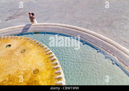 Couple water fountain Piazza del Popolo Rome Italy - Stock Photo