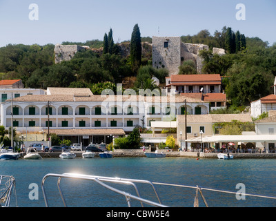 Pretty village of Kassiopi on the island of Corfu which is a Greek island in the Ionian Sea. - Stock Photo