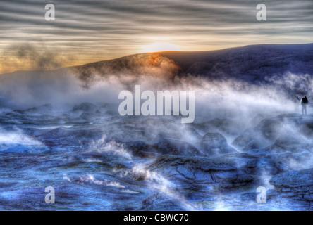 Fumaroles and strange landscapes at Sol de Manana geothermal field in Bolivia near the Bolivia/Chile border - Stock Photo