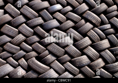Stack of old tires in a garage - Stock Photo