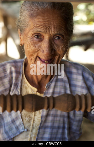 burma myanmar an old woman with white hair and tanned
