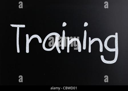 Text handwritten with white chalk on a blackboard - Stock Photo